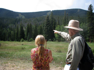 Dave Hallock points out existing ski runs and lifts as well as proposed runs and lifts to Tehri Parker.