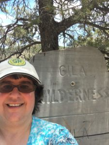 Alison next to Gila Wilderness Sign