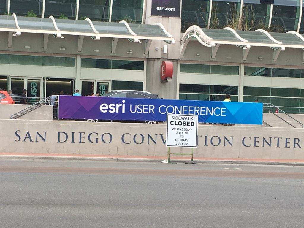 Sidewalk closure sign in front of Esri UC Banner