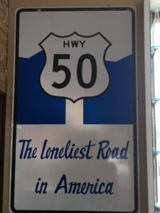 Sign: HWY 50; The loneliest Road in America
