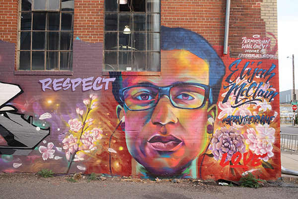 A mural of Elijah McClain painted on a building in Denver